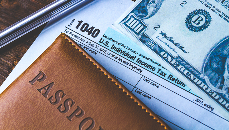 1040 tax return with Passport and $100 bill