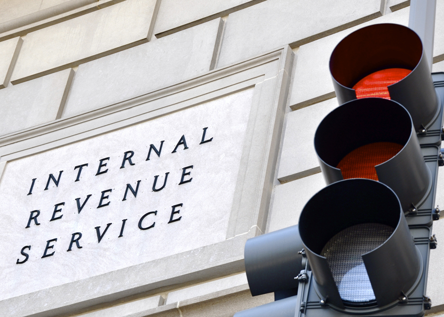 Internal Revenue Service sign next to traffic light