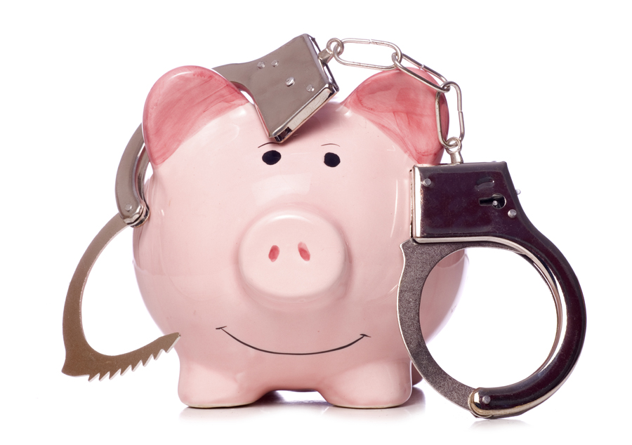 Piggy bank with handcuffs hanging on it