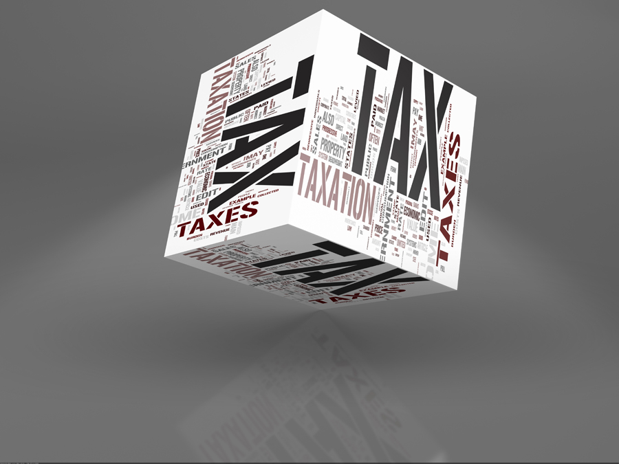 Cube with Tax words on written on it