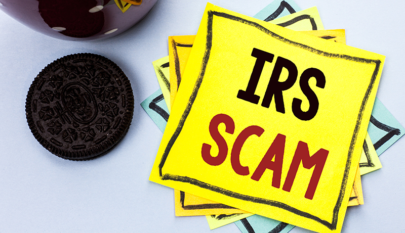 IRS Scam written on a sitcky-note