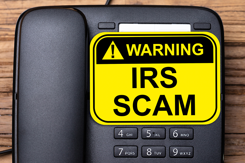 IRS Scam sign on a Telephone