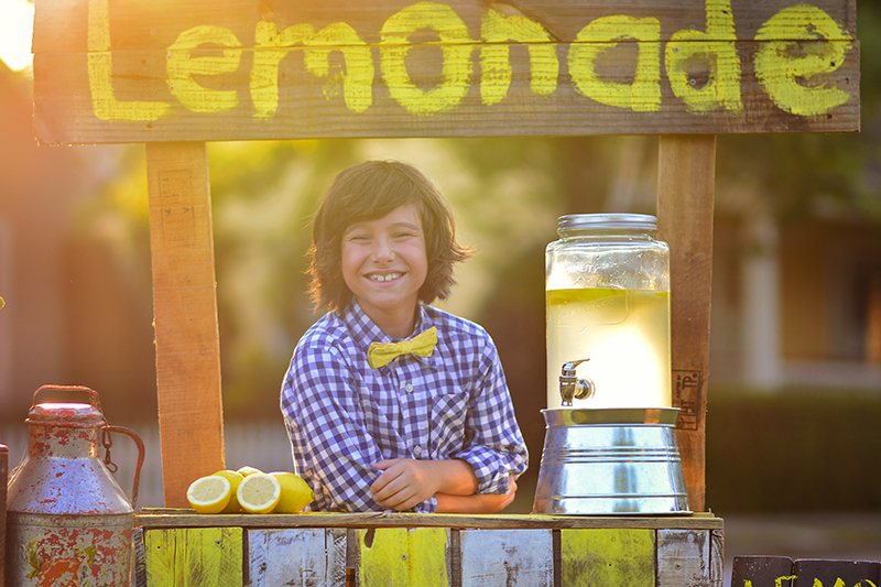 boy selling lemonade