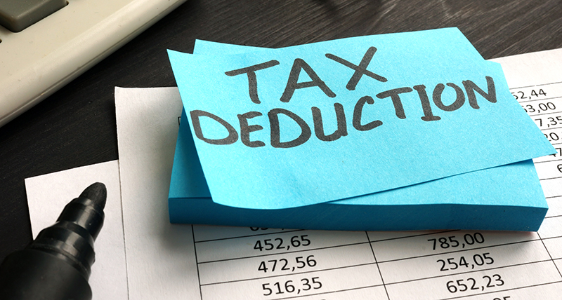 Tax Deduction written on a sticky-note