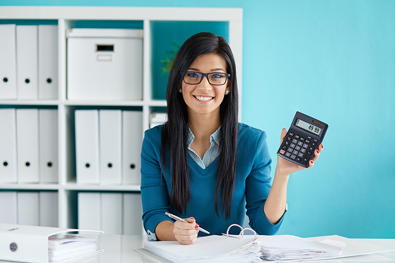 Tax Professional holding up a Calculator