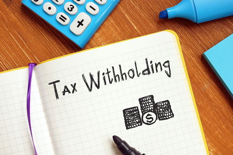 Tax WIthholding written in a notebook