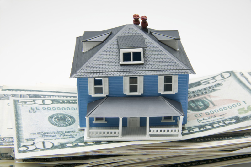 House on top of stack of money