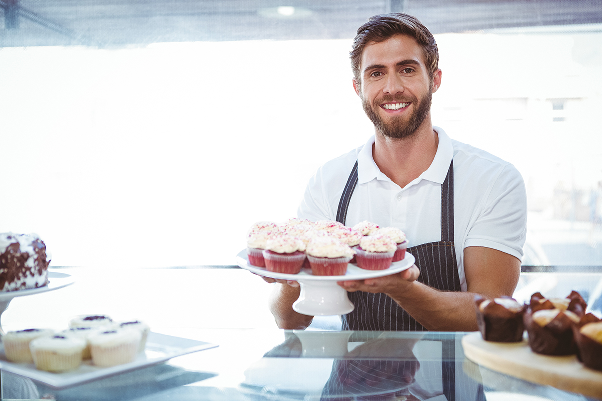 Man Holding Cupcakes