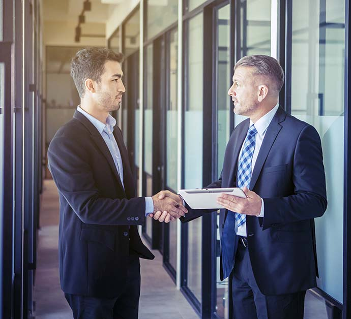 Tax professionals shaking hands
