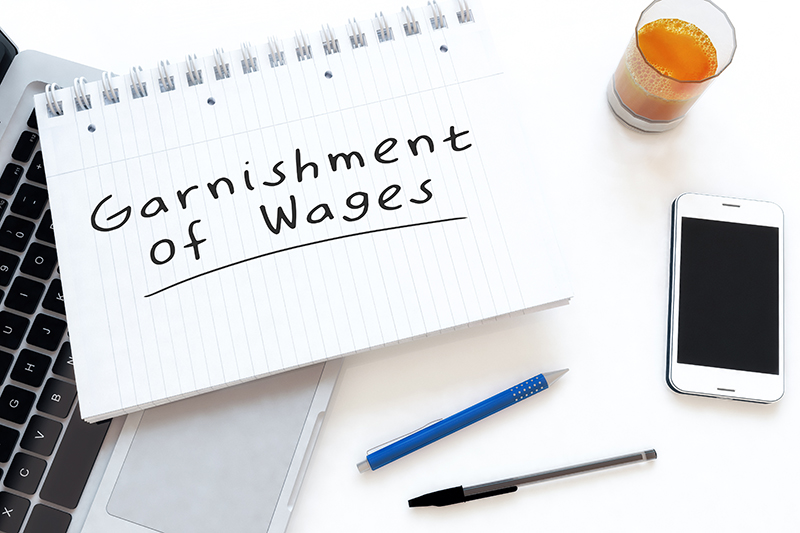 Garnishment of Wages written on a notepad
