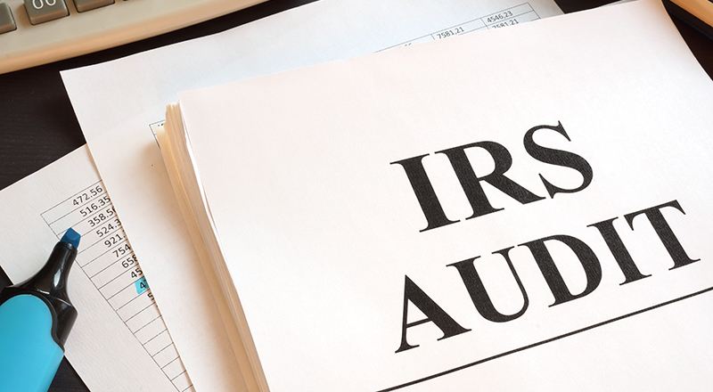 IRS Audit Written on a Paper