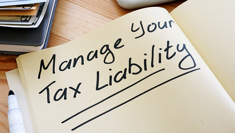 Manage Your Tax Liability written in a notebook