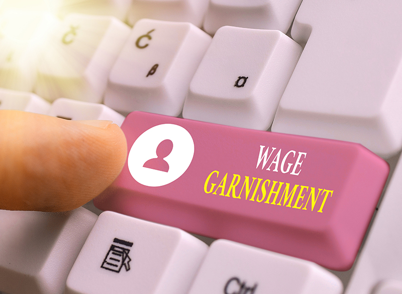 Wage Garnishment Button on a Keyboard