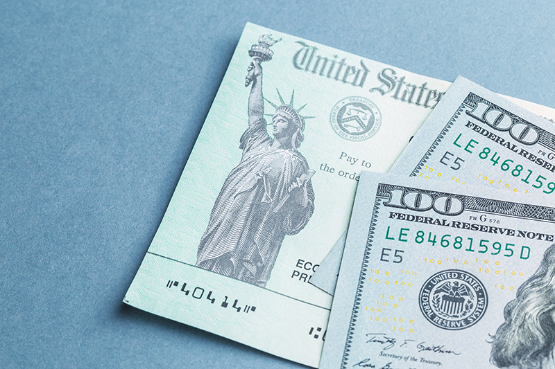 Stimulus Check with $100 bills