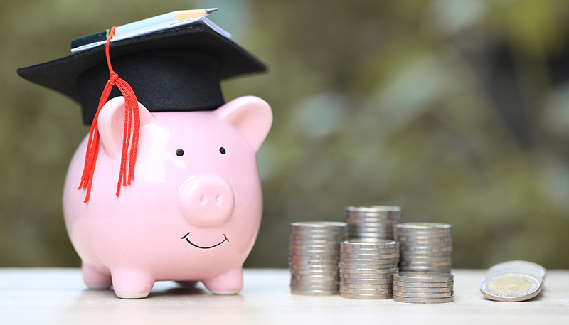 Piggy bank with graduation hat on
