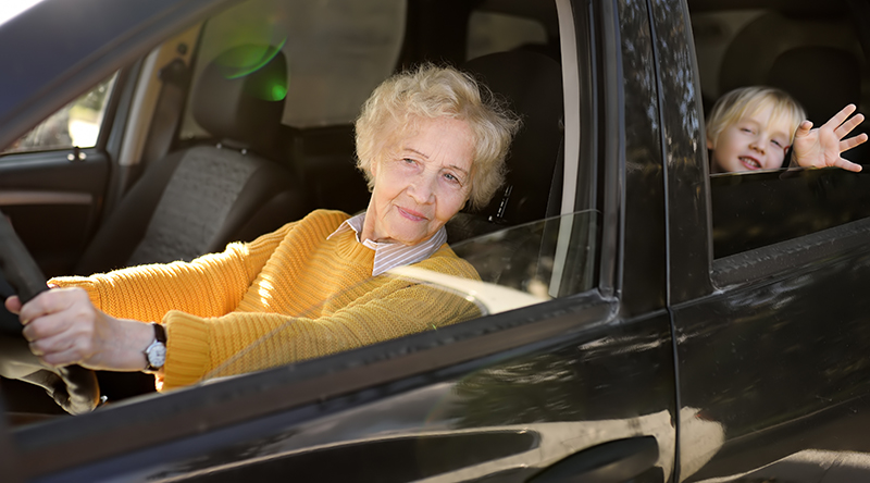 Grandmother driving Grandchild