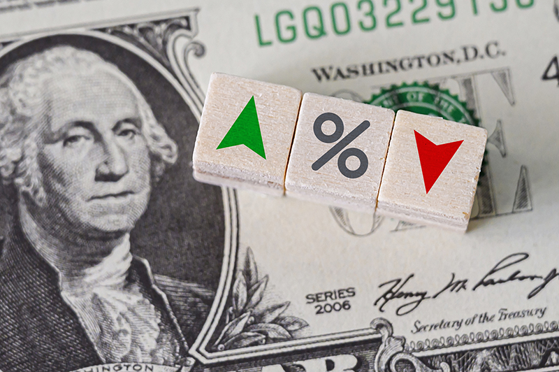 Percentage sign with dollar bill in the background